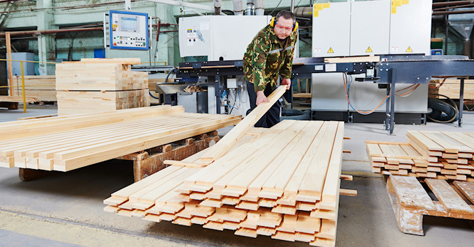 Man stacking wood